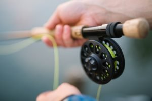 Holding the fly line for casting